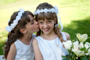 Young girls doing her catholic first holy communion